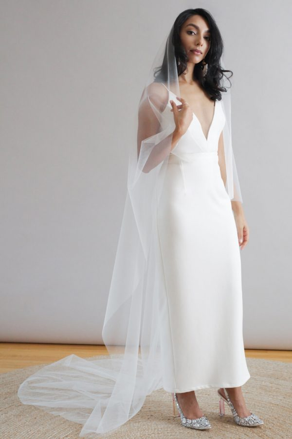 Simple wedding dress with plunging v-neck, spaghetti straps