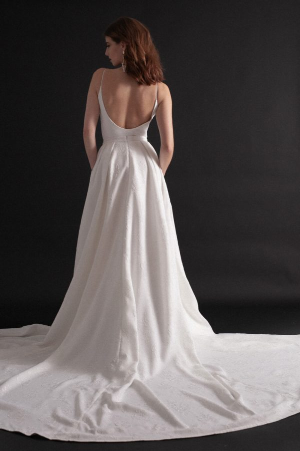 Wedding gown bridal separates with low back, thin straps and full jacquard box pleat skirt.