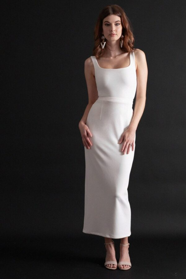 Figure hugging bodysuit and skirt combination with low, square neckline, shoulder straps, and ankle length column skirt.