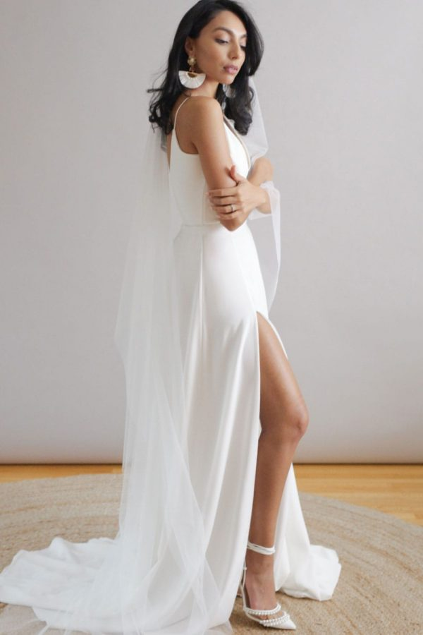 Bridal separates pairing of a deep v-neck bodysuit with low back and spaghetti straps, and a full a-line, crepe skirt with thigh-high slit.
