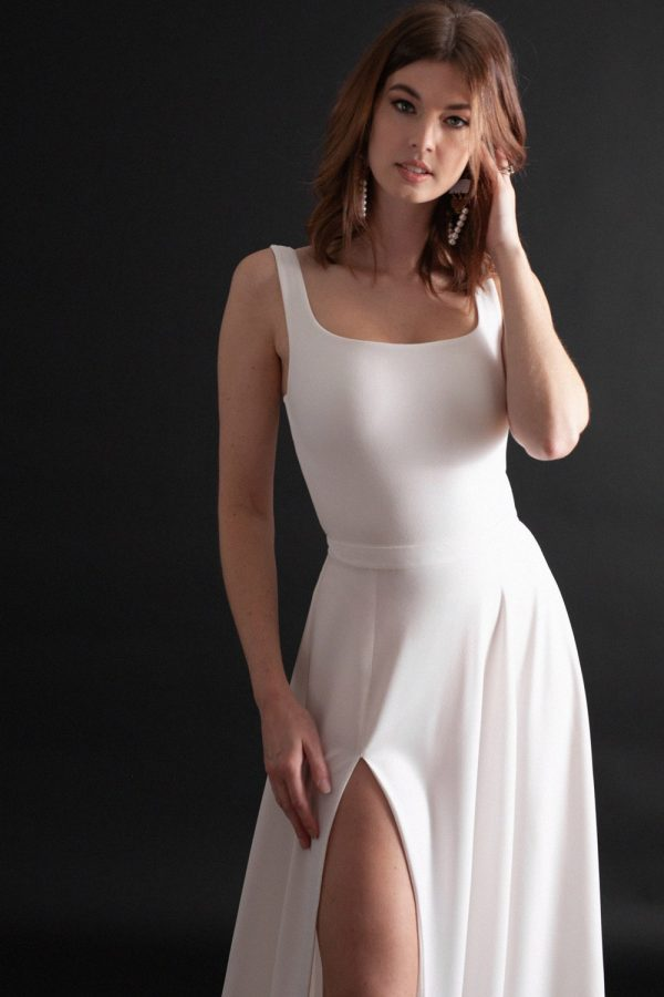Bridal separates combination with low, square neckline, shoulder straps, and full a-line skirt with thigh-high slit.