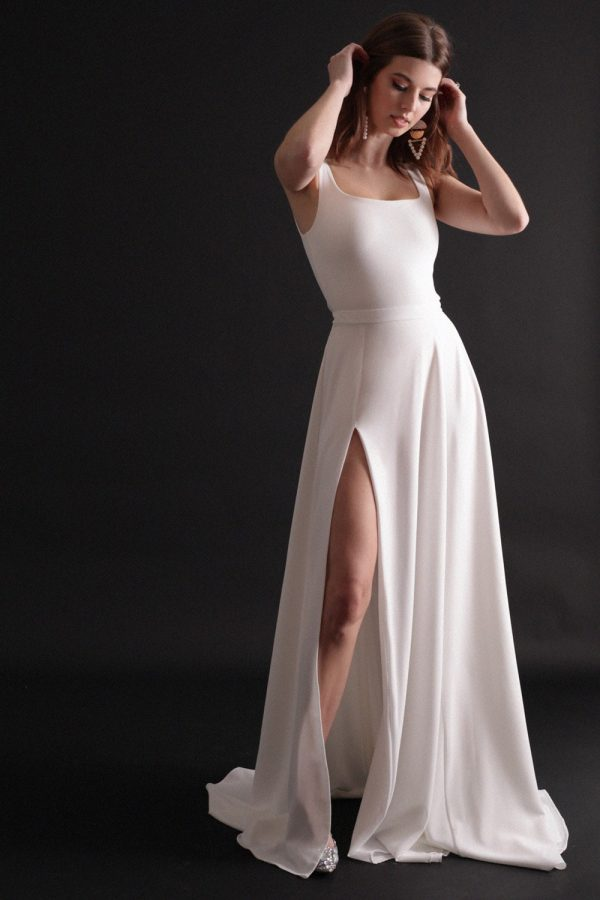 Bridal separates combination with low, square neckline, shoulder straps, and full a-line skirt with thigh slit.