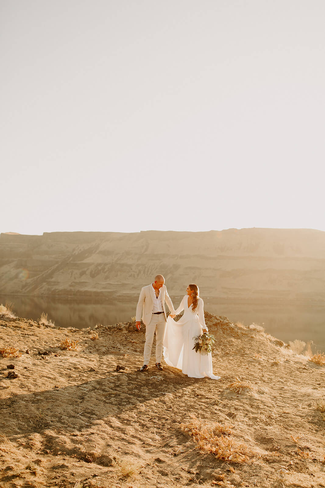 A groom and a bride in the desert